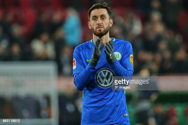 Yunus Malli of Wolfsburg claps after the Bundesliga match between FC Augsburg and VfL Wolfsburg at WWKArena on November 25 2017 in Augsburg Germany