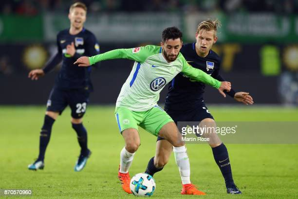 Yunus Malli of Wolfsburg is challenged by Arne Maier of Berlin during the Bundesliga match between VfL Wolfsburg and Hertha BSC at Volkswagen Arena...