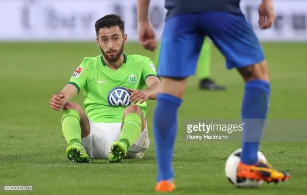Yunus Malli of Wolfsburg sits on the pitch during the Bundesliga Playoff first leg match between VfL Wolfsburg and Eintracht Braunschweig at...