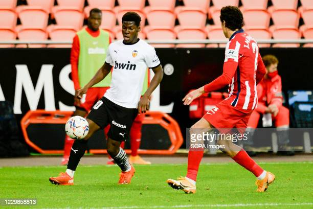 Yunus Musah of Valencia and Jose Gimenez of Atletico de Madrid in action during the Spanish La Liga football match between Valencia and Atletico de...