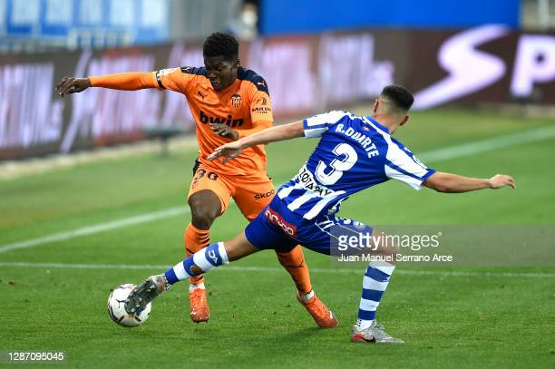 Yunus Musah of Valencia battles for possession with Ruben Duarte of Deportivo Alaves during the La Liga Santander match between Alaves and Valencia...