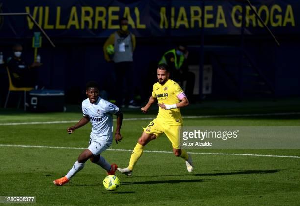 Yunus Musah of Valencia is closed down by Mario Gaspar of Villarreal during the La Liga Santander match between Villarreal CF and Valencia CF at...