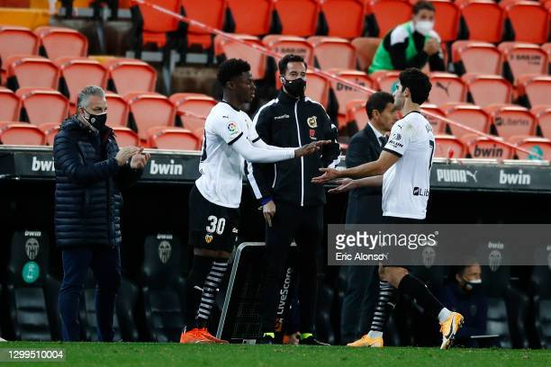 Yunus Musah replaces Gonçalo Guedes of Valencia CF during the La Liga Santander match between Valencia CF and Elche CF at Estadio Mestalla on January...