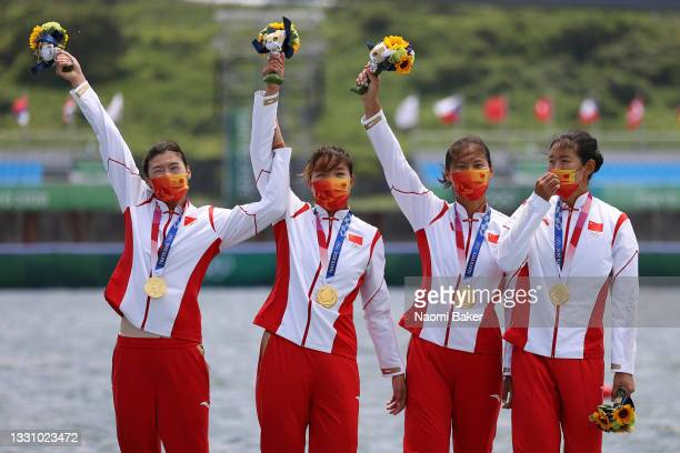 Yunxia Chen, Ling Zhang, Yang Lyu and Xiaotong Cui of Team China poses with the gold medal after winning the Women's Quadruple Sculls Final A on day...