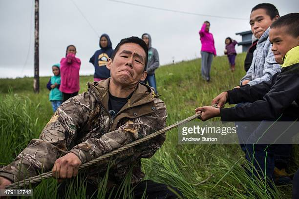 Yupik children help recover a snow mobile which sank when its owner attempted drive across a pond on June 30 2015 in Newtok Alaska Newtok which has a...