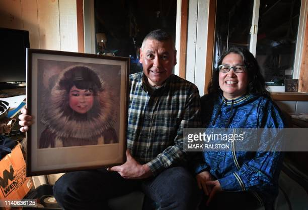 Yupik Eskimo elder Willard Church and his wife Mary hold his mothers portrait in the town of Quinhagak on the Yukon Delta in Alaska on April 14 2019...