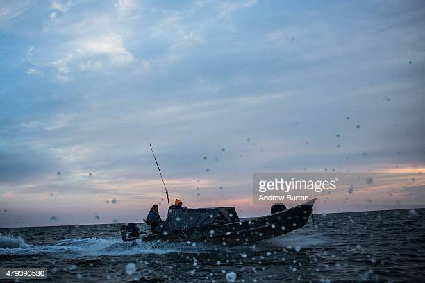 Yupik men head back to their village after a day of salmon fishing on July 1 2015 in Newtok Alaska Newtok has a population of approximately of 375...