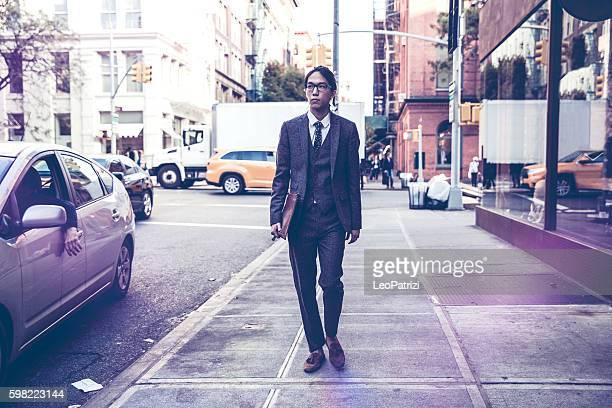 Yuppie businessman walking in Soho New York
