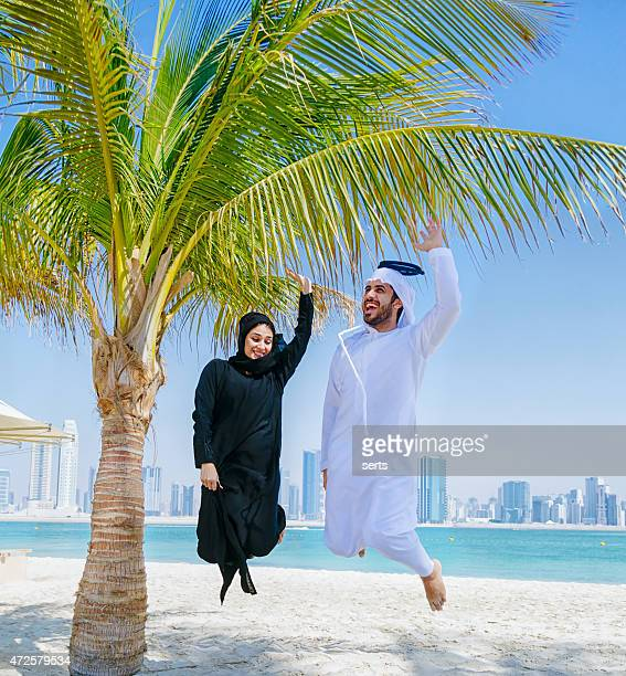 Yuppie! - Happy Arab Couple Jumping In The Air
