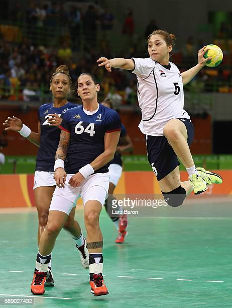 Yura Jung of Korea shoots on goal next to Alexandra Lacrabere of France during the Womens Preliminary Group B match between Korea and France on Day 7...