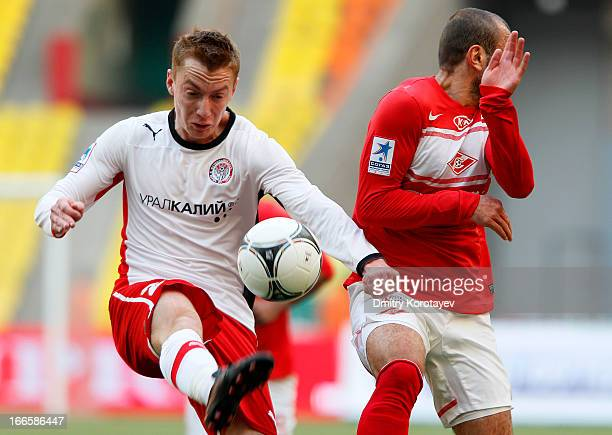 Yura Movsisyan of FC Spartak Moscow battles for the ball with Andrei Semyonov of FC Amkar Perm during the Russian Premier League match between FC...