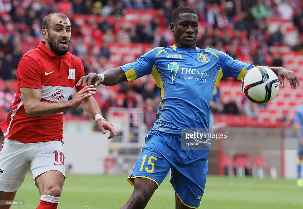 Yura Movsisyan of FC Spartak Moscow challenged by Bastos of FC Rostov Rostov-on-Don during the Russian Premier League match between FC Spartak Moscow v FC Rostov Rostov on Don at the Arena Otkritie stadium on September 13, 2015 in Moscow, Russia.