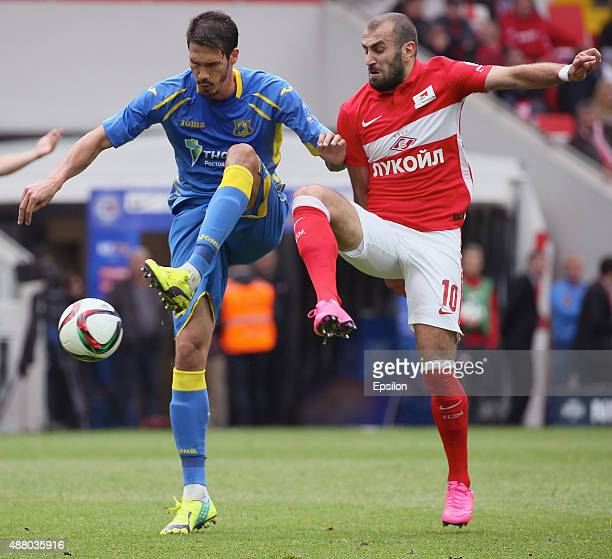 Yura Movsisyan of FC Spartak Moscow challenged by Cesar Navas of FC Rostov RostovonDon during the Russian Premier League match between FC Spartak...