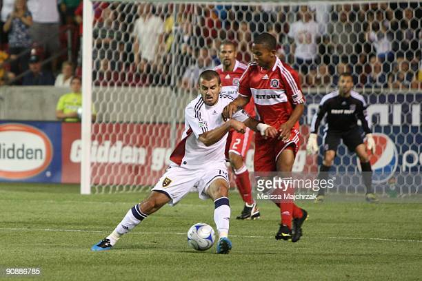 Yura Movsisyan of Real Salt Lake battles for the ball against Mike Banner of Chicago Fire at Rio Tinto Stadium on September 12 2009 in Sandy Utah