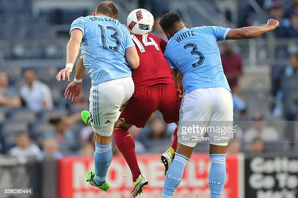 Yura Movsisyan of Real Salt Lake is sandwich by Frederic Brillant of New York City FC and Ethan White of New York City FC as they go for the ball...
