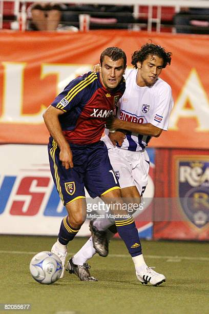 Yura Movsisyan of Real Salt Lake kicks the ball against Deportivo Saprissa at Rice Eccles Stadium on July 23 2008 in Salt Lake City Utah