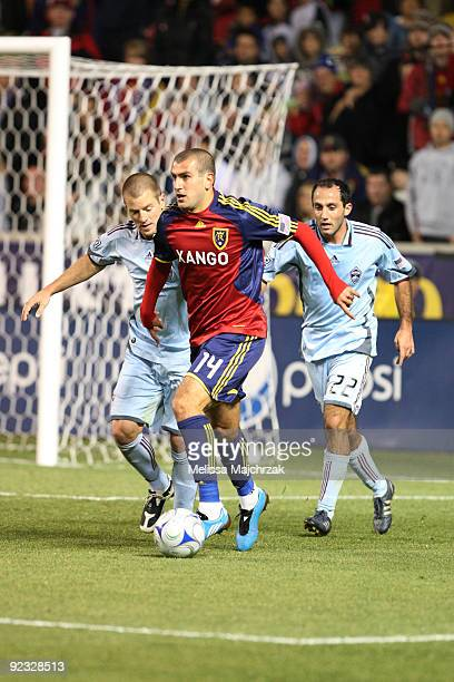 Yura Movsisyan of Real Salt Lake kicks the ball against Nick LaBrocca and Kosuke Kimura of Colorado Rapids at Rio Tinto Stadium on October 24 2009 in...