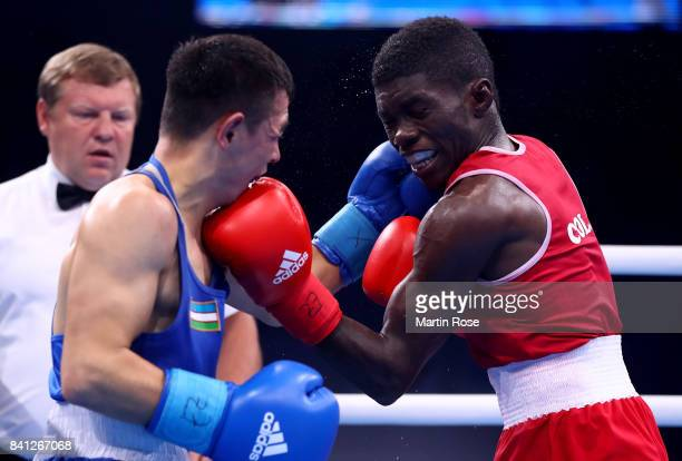 Yurberjen Martinez Rivas of Columbia and Hasanboy Dusmatov of Uzbekistan fight in the Men's light fly during the semi finals of the AIBA World Boxing...