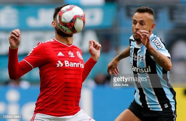 Yuri Alberto of Internacional and Rafinha of Gremio fight for the ball during the final of Rio Grande Do Sul State Championship 2021 between Gremio...