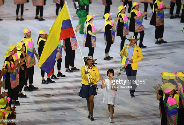 Yuri Alvear Orjuela of Colombia carries the flag during the Opening Ceremony of the Rio 2016 Olympic Games at Maracana Stadium on August 5 2016 in...