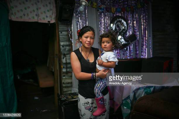 Yuri Andrea a single mother, who works recycling to help her mother as she raises her 2-year-old daughter at the improvise settlement at the Paraiso...