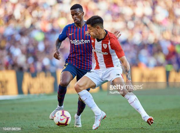Yuri Berchiche Izeta of Athletic Club de Bilbao competes for the ball with Nelson Semedo of FC Barcelona during the La Liga match between FC...
