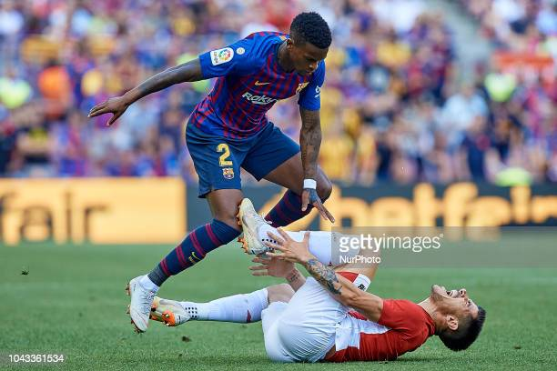 Yuri Berchiche Izeta of Athletic Club de Bilbao reacts on the pitch next to Nelson Semedo of FC Barcelona during the La Liga match between FC...