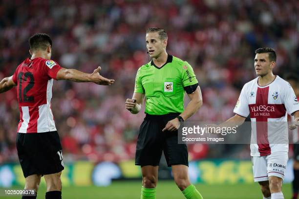Yuri Berchiche of Athletic Bilbao Referee Alberola Rojas during the La Liga Santander match between Athletic de Bilbao v SD Huesca at the Estadio San...