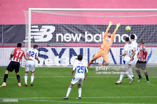 Yuri Berchiche of Athletic Bilbao scores their team's first goal past Marko Dmitrovic of SD Eibar during the La Liga Santander match between Athletic...