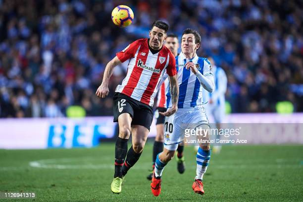 Yuri Berchiche of Athletic Club competes for the ball with Mikel Oyarzabal of Real Sociedad during the La Liga match between Real Sociedad and...