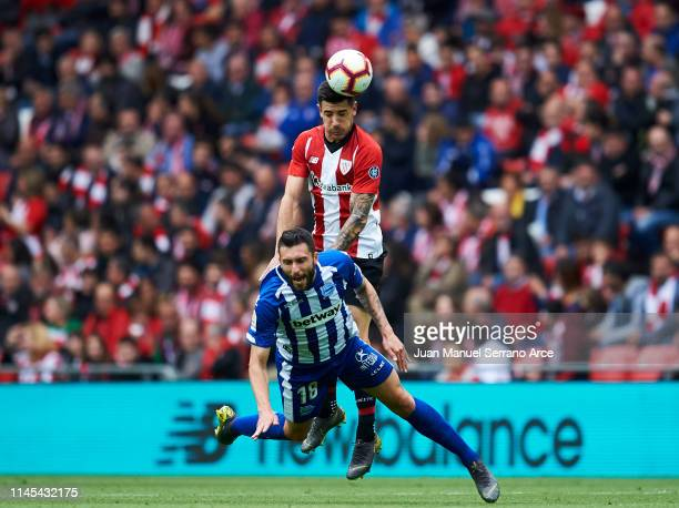 Yuri Berchiche of Athletic Club duels for the ball with Borja Gonzalez of Deportivo Alaves during the La Liga match between Athletic Club and...