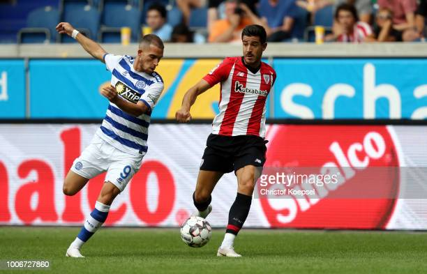 Yuri Berchiche of Bilbao challenges Ahmet Engin of Duisburg during the third place match between MSV Duisburg and Athletic Bilbao at...