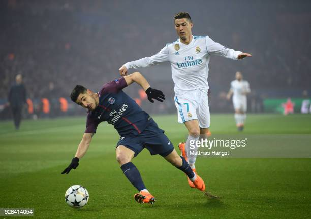 Yuri Berchiche of Paris is challenged by Cristiano Ronaldo of Madrid during the UEFA Champions League Round of 16 Second Leg match between Paris...