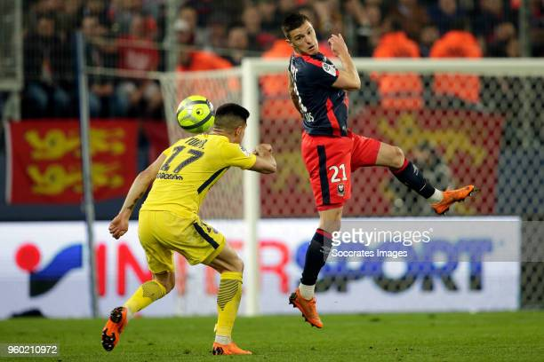 Yuri Berchiche of Paris Saint Germain Frederic Guilbert of Caen during the French League 1 match between Caen v Paris Saint Germain at the Stade...