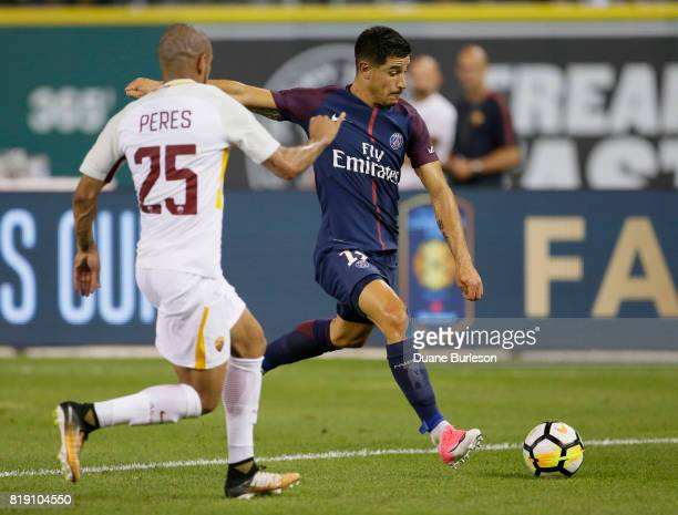 Yuri Berchiche of Paris SaintGermain drives on the goal against Bruno Peres of AS Roma during the second half at Comerica Park on July 19 2017 in...