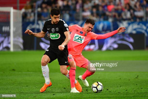 Yuri Berchiche of PSG and Stef Peeters of Caen during the French Cup Semi Final match between Caen and Paris Saint Germain on April 18 2018 in Caen...