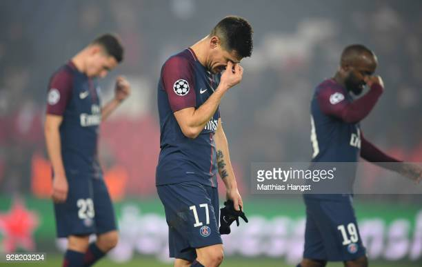 Yuri Berchiche of PSG and team mates look dejected in defeat after the UEFA Champions League Round of 16 Second Leg match between Paris Saint-Germain...