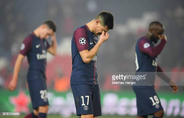 Yuri Berchiche of PSG and team mates look dejected in defeat after the UEFA Champions League Round of 16 Second Leg match between Paris SaintGermain...