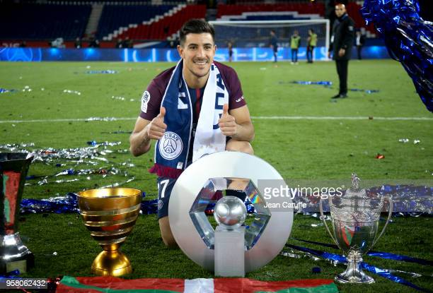Yuri Berchiche of PSG celebrates during the French Ligue 1 Championship Trophy Ceremony following the Ligue 1 match between Paris SaintGermain and...
