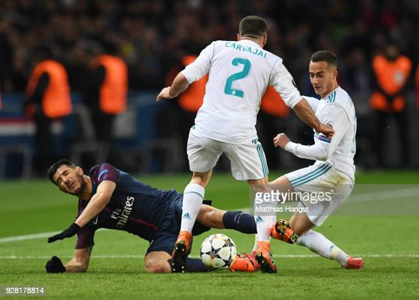 Yuri Berchiche of PSG is challenged by Daniel Carvajal and Lucas Vazquez of Real Madrid during the UEFA Champions League Round of 16 Second Leg match...
