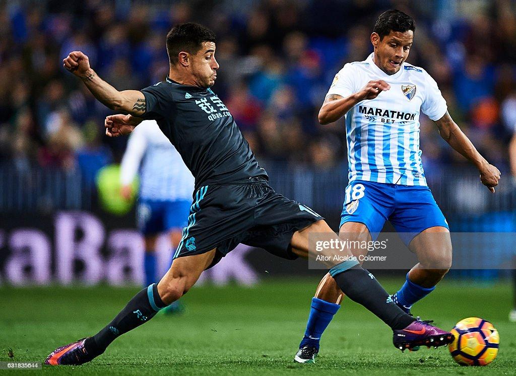 Yuri Berchiche of Real Sociedad (L) competes for the ball with Roberto Rosales of Malaga CF (R) during the La Liga match between Malaga CF and Real Sociedad de Futbol at La Rosaleda Stadium on January 16, 2017 in Malaga, Spain.