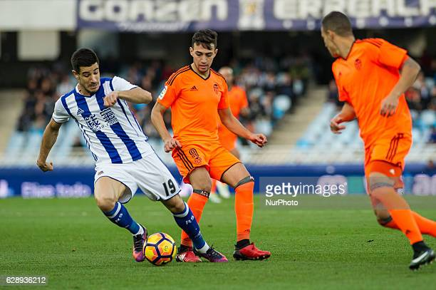 Yuri Berchiche of Real Sociedad duels for the ball with Munir of Valencia during the Spanish league football match between Real Sociedad and Valencia...