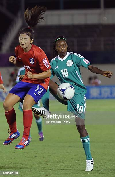 Yuri Choe of Korea Republic and Ngozi Okobi of Nigeria compete for the ball during the FIFA U-20 Women's World Cup Japan 2012, Group B match between...