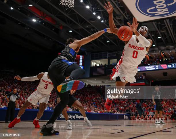 Yuri Collins of the Saint Louis Billikens fouls Rodney Chatman of the Dayton Flyers while shooting during the first half at UD Arena on February 8,...