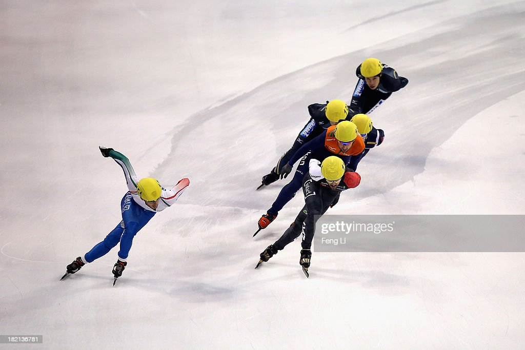 Yuri Confortola of Italy (Left) and Charles Hamelin of Canada (Right Front) compete in the Men's 1500m Semi Final during day three of the Samsung ISU World Cup Short Track at the Oriental Sports Center on September 28, 2013 in Shanghai, China.