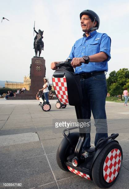 Yuri Cortez a Mexican photographer drives a segway as he visits Zagreb on August 31 2018 Cortez who became known worldwide after taking closeup shots...