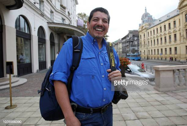 Yuri Cortez a Mexican photographer poses as he visits Zagreb on August 31 2018 Cortez who became known worldwide after taking closeup shots of...