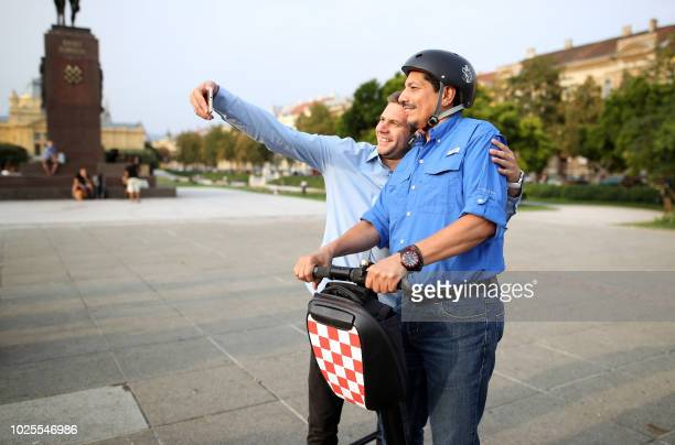 Yuri Cortez a Mexican photographer poses with a resident in Zagreb on August 31 2018 Cortez who became known worldwide after taking closeup shots of...