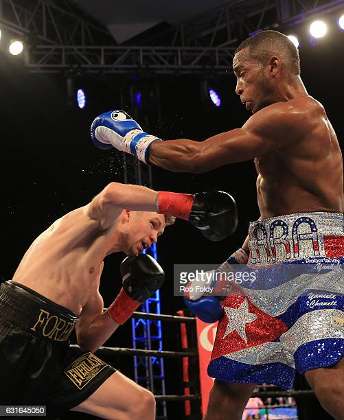 Yuri Foreman fights against Erislandy Lara during the second round of their WBA World Super Welterweight Championship bout at Hialeah Park on January...