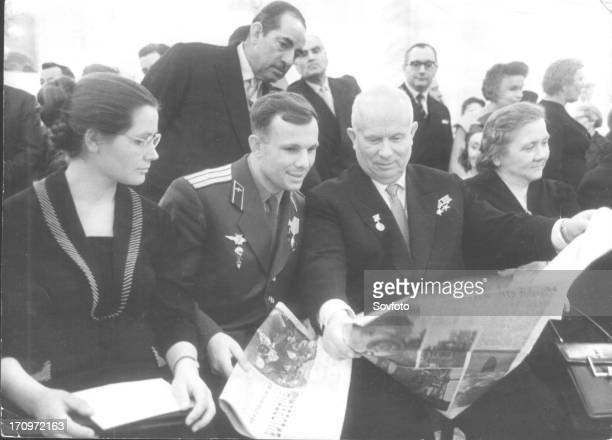 Yuri gagarin and his wife with nikita khrushchev at areception held in his honor at the grand kremlin palace on april 14 1961